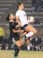 Redwood's Jill Nelsen battles for possession against