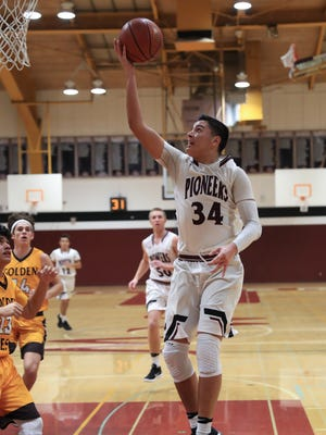 Mt Whitney's Anthony Valencia goes up for a layup in a West Yosemite League high school boys basketball game against Golden West.