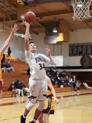 Mt Whitney's Anthony Valencia shoots in a West Yosemite League high school boys basketball game against Golden West.