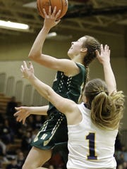 Howell's Alexis Miller drives to the basket while guarded