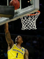 Michigan guard Charles Matthews (1) makes a layup against Texas A&M during second half of U-M's 99-72 win over Texas A&M in the Sweet 16 of the NCAA tournament in Los Angeles on Thursday, March 22, 2018.