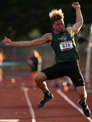 West Salem's Simon Thompson competes in the boys triple jump during the Greater Valley Conference district championship track and field meet at West Salem High School on Thursday, May 10, 2018.
