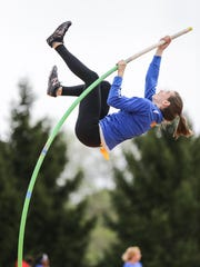 Carmel pole vaulter Kara Deady takes a warm up vault