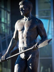 A bronze Louie the Lumberjack statue at Northern Arizona