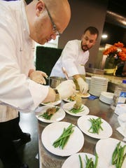 Motor City's Iridescence's Chef de Cuisine Benjamin Meyer, left, and Iridescence's Saucier Chef Cassey Cummings are working to get the food plated during the Detroit Free Press Feast Thanksgiving tasting event at the Great Lakes Culinary Center in Southfield.