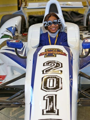 BJ Brown, with Pacers Sports and Entertainment, is all smiles as she sits in the New Year's Eve IndyCar on Monday.