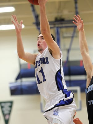 Clear Creek Amana's Keyan McAreavy goes up for a shot during the Clippers' game against South Tama at CCA on Monday, Feb. 23, 2015. David Scrivner / Iowa City Press-Citizen