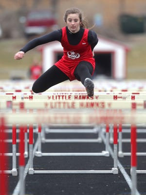 City High's Sara Blowers competes in the 4x100 shuttle hurdle race at the Sherwood Relays on Wednesday. The Little Hawks finished third in the event.