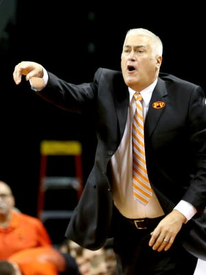 Oregon State head coach Wayne Tinkle calls out to his team in the first half of the Oregon State vs. Oregon Civil War men's basketball game at the Matthew Knight Arena in Eugene on Saturday, Jan. 3, 2015. The Ducks lead 29-27 at the half.