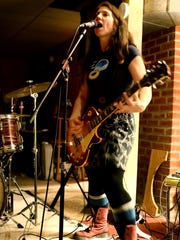 Karen Holman rehearses with her punk rock band in the basement of her home.