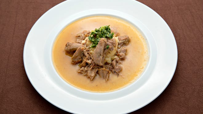 Osso Buco is usually served bone-in, but Susan Mayer's Top Home Chef version is shredded and served over parsnip puree.