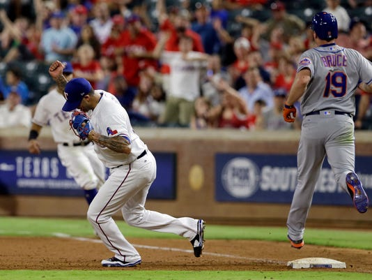 Texas Rangers closer Matt Bush, left, celebrates completing the double pay on a hit by New York Mets' Jay Bruce (19) in the ninth inning of an interleague baseball game, Tuesday, June 6, 2017, in Arlington, Texas. The Mets' Michael Conforto was out at second in the 10-8 Rangers win. (AP Photo/Tony Gutierrez)