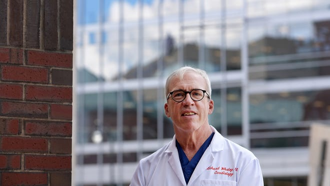 Dr. Richard Wholey, an interventional and clinical cardiologist, stands outside St. Vincent Hospital Wednesday.