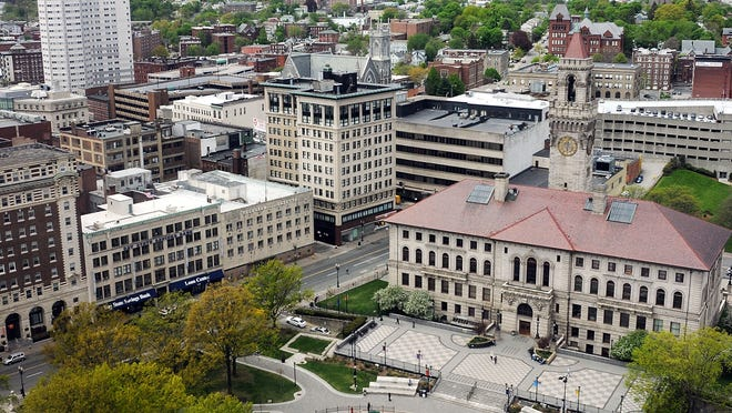Worcester City Hall is seen in the bottom right on May 12, 2011. City Manager Edward Augustus is asking the City Council to approve a $15 million loan order to begin installing devices to address air quality in 85 city schools and public buildings.