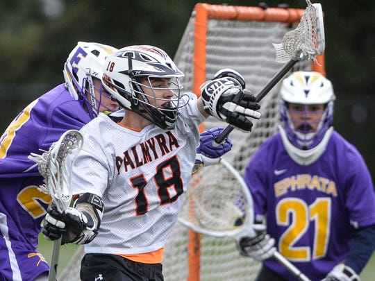 Palmyra's Alec Richard fights off Ephrata's Mason Klaus during the Cougars' 13-4 win over Ephrata on Monday, their first of the season.