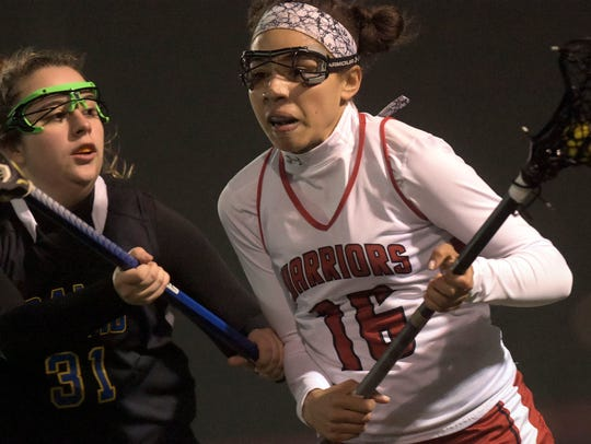 Susquehannock's Ashley Grimes moves the ball with pressure from Kennard-Dale's Autumn Kramer during lacrosse action at Susquehannock Tuesday, April 3, 2018. Susquehannock won the game in overtime. Bill Kalina photo