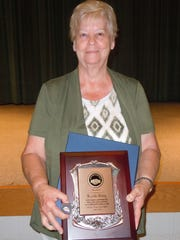 Lucille Riley displays her plaque for 35 years of service.