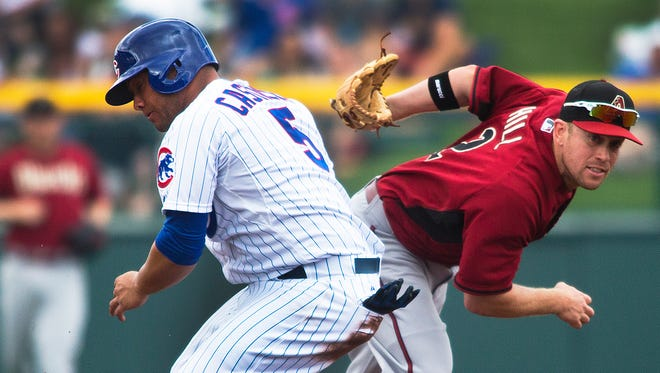 Aaron Hill (right) against the Cubs.