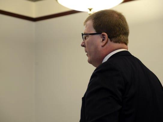 Cascade County prosecutor Matt Robertson speaks to