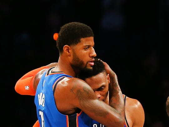 Oklahoma City Thunder forward Paul George (13) is congratulated by guard Russell Westbrook (0) after hitting the game-winning three-point shot against the Brooklyn Nets. (Andy Marlin, USA TODAY Sports)