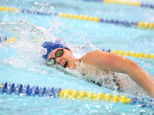 McNary's Marissa Kuch competes 100 Yard Freestlye during the Greater Valley Conference District meet Friday, Feb. 12, 2016, at the McMinnville Aquatic Center.