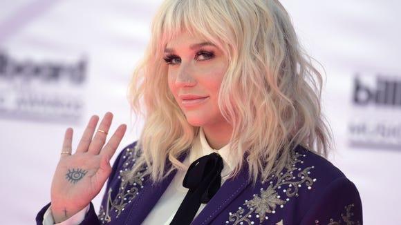 Kesha arrives at the Billboard Music Awards.