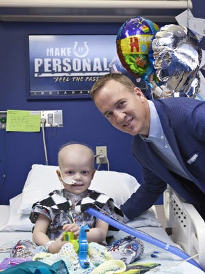 Patient Henry Wooten with Peyton Manning during a 2013 visit to Peyton Manning Children's Hospital.