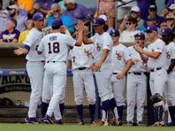 LSU pitcher Cole Henry (18) is greeted at the dugout after finishing the first inning against Florida State in Game 1 of the NCAA college baseball super regional tournament in Baton Rouge, La., Saturday, June 8, 2019. (AP Photo/Gerald Herbert)