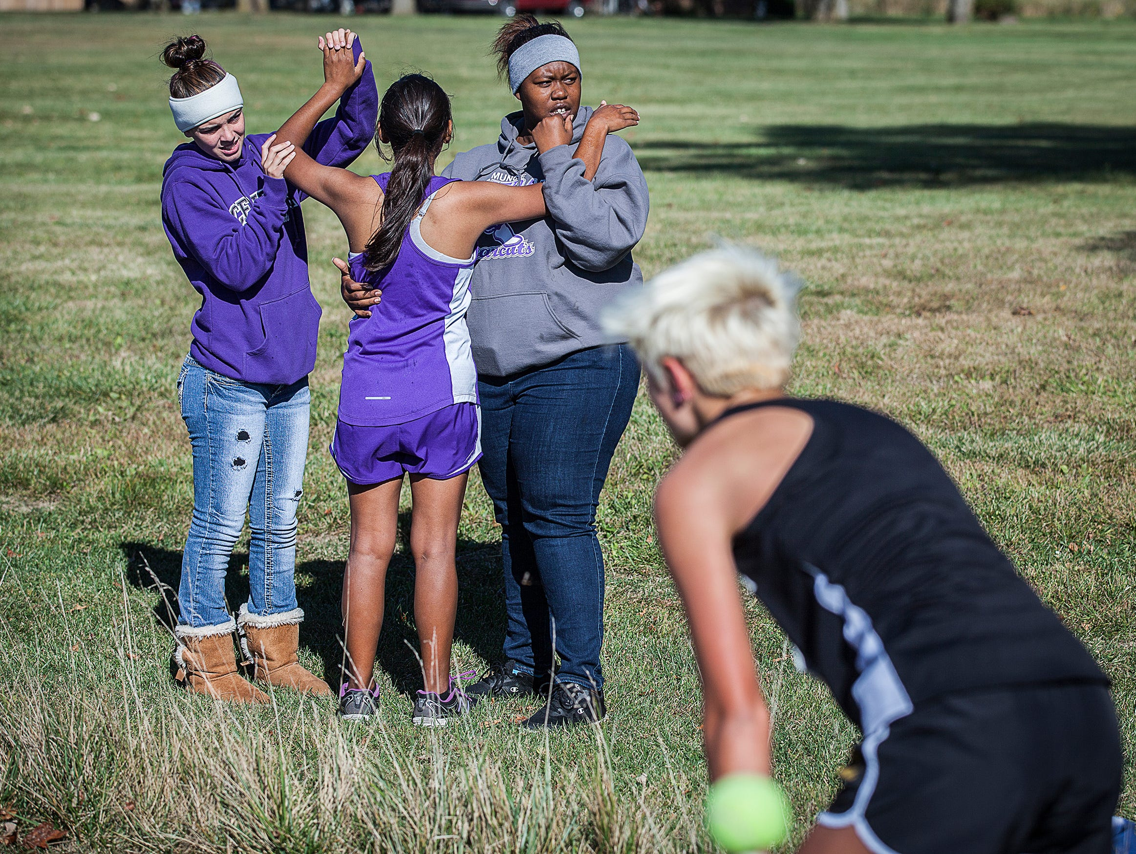 Female racers finish during the cross country sectionals at the Sportsplex in Muncie on Saturday, Oct. 10, 2015.