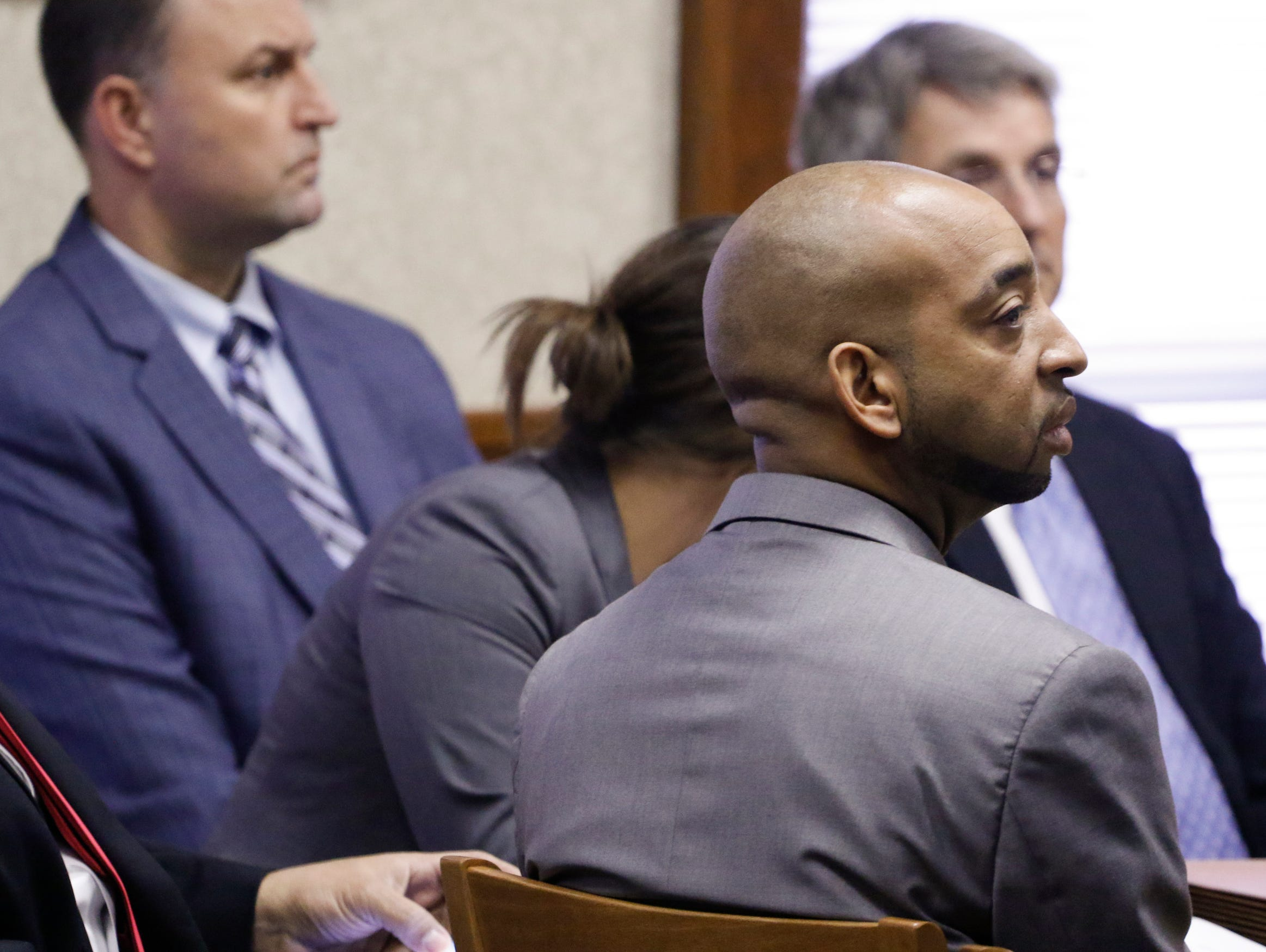 Ooltewah High School basketball head coach Andre Montgomery, front right, appears before Judge Rob Philyaw in Hamilton County Juvenile Court, Thursday, Jan. 21, 2016, in Chattanooga, Tenn. Judge Robert Philyaw denied motions to dismiss charges against Montgomery, and two other high school officials, in facing allegations that they failed to report the sexual abuse of school basketball players by teammates. A preliminary hearing is set for Feb. 15. (Dan Henry/Chattanooga Times Free Press via AP)