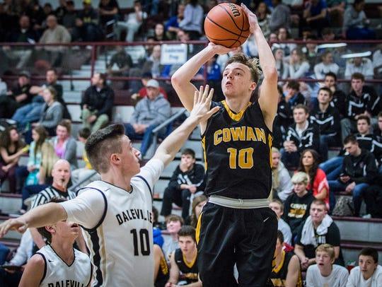 Cowan's Clayton Kiplinger shoots past Daleville's defense