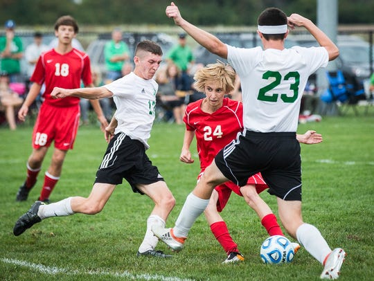 Jay County's Ian McCombs is stopped by Yorktown's defense