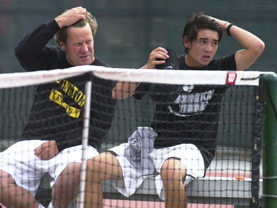 Ron Schaub talks strategy during a changeover with Nicky Wong, one of the best players to come thorugh his powerhouse tennis program.