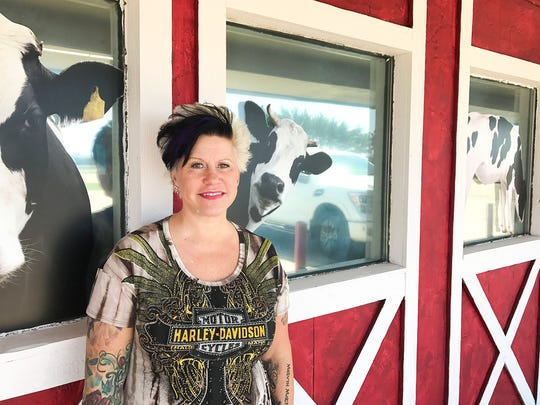 Fudgin Delicious Ice Cream & Hom Decor owner Anne McKeehan stands outside her soon-to-be second location in Rice.