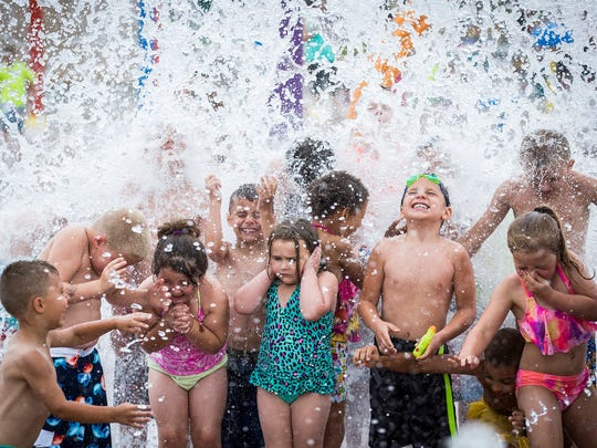 Children play at the Daleville Town Hall Park Splash Pad.