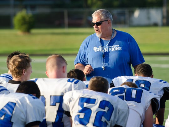 Oak Creek football coach Mike Bartholomew addresses