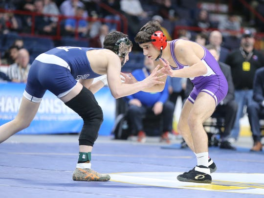 Hilton's Greg Diakomihalis wrestles in the 113-pound championship match of the NYSPHSAA Wrestling Championships at Times Union Center in Albany on Saturday, February 24, 2018.