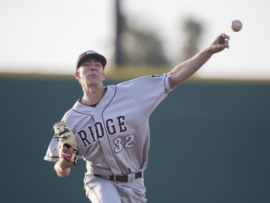 Pitcher Matthew Liberatore (32) of the Mountain Ridge Mountain Lions warms up against the Sandra Day O'Connor Eagles at Brazell Field at Grand Canyon University on Thursday, April 19, 2018 in Phoenix, Arizona.