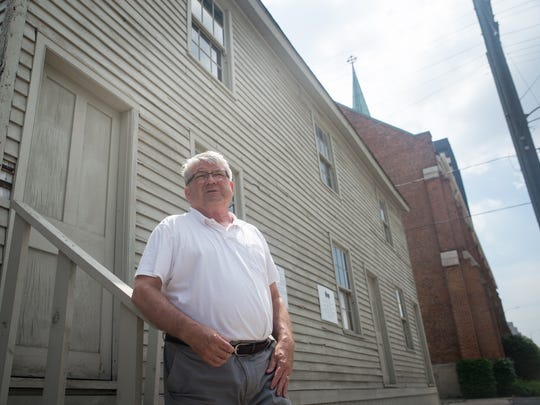 Tim McKay in front of the Worker Row House in Corktown,