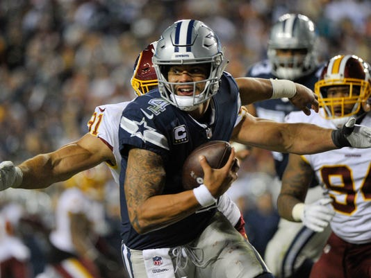 ca75d6786 636757509387419387-WD12.jpg. Washington Redskins linebacker Ryan Kerrigan  (91) closes in on Dallas Cowboys quarterback Dak Prescott ...