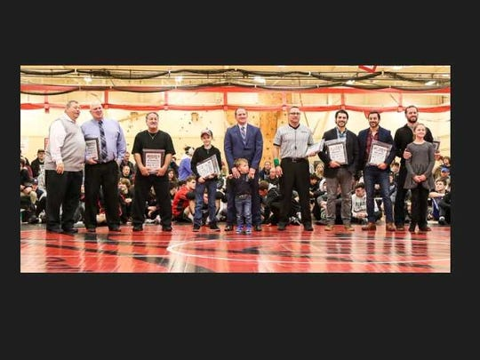 Region 5 Hall of Fame Wrestling 2018 inductees (L to R): Committee chairman Ron Mazzola, Steve Gibble, Joe Nisivoccia (accepting for Ed Tomkiewicz), Brian Brady (with children Jackson and Bryce Brady), Roy Dragon, Mark Savino, Mike Savino, John Van Doren (with daughter Quinn).