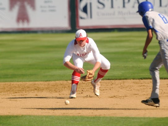 Albany second baseman Josh Dyer (1) fields a ground