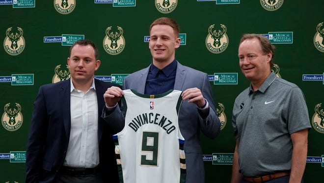 Donte DiVincenzo poses with head coach Mike Budenholzer, right, and general manager Jon Horst when being introduced to the Milwaukee media. The Bucks signed DiVincenzo on Tuesday.