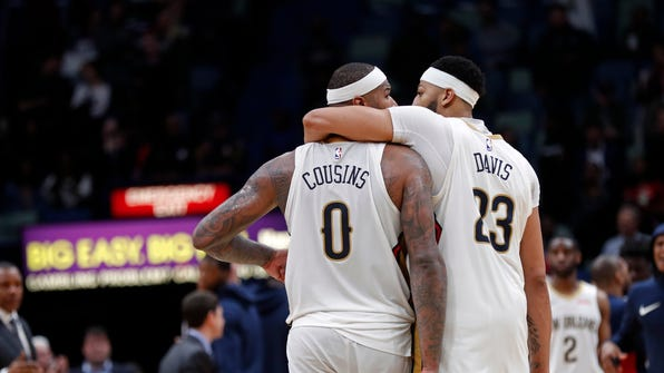 New Orleans Pelicans forward Anthony Davis (23) and center DeMarcus Cousins (0) walk down court during overtime of an NBA basketball game against the Chicago Bulls in New Orleans, Monday, Jan. 22, 2018. The Pelicans won in double overtime, 132-128. (AP Photo/Gerald Herbert) ORG XMIT: LAGH101