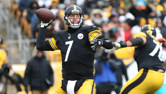 Pittsburgh Steelers quarterback Ben Roethlisberger (7) throws the ball against the Miami Dolphins during the first half in the AFC Wild Card playoff football game at Heinz Field.