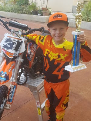 Richard Wenden, 7, a member of the Guam International Raceway Motorcycle and ATV Club (GIRMAC), started riding at age 3 with his  motocross-riding dad Tim Wenden's guidance. At age 4, he began to race competitively as part of the GIRMAC* Club, and now rides a KTM50, sponsored by Rocky Mountain Precast. He races his 50cc against boys mostly 3 or 4 years older, riding 65cc bikes. He is pictured here with his second place trophy in the 65cc Class of the 2017 Monster Energy Guam MX Championships. Wenden has been selected from hundreds of applicants from all over the world to participate in the KTM Jr. Supercross Challenge (KJSC) to be held May 6 (May 7, Guam time) in Las Vegas, Nevada.