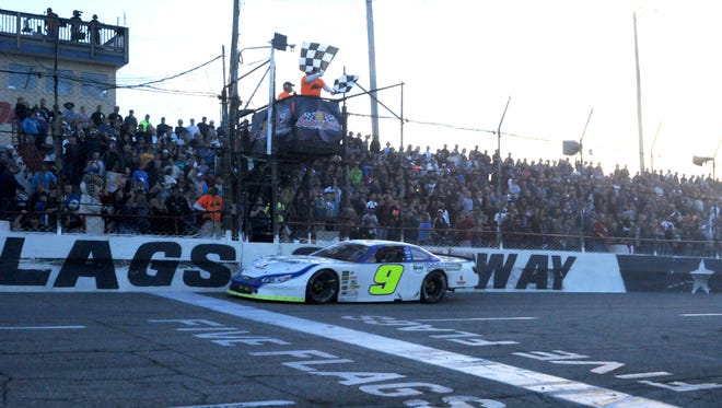 Chase Elliott crosses the finish line at the 48th Annual Snowball Derby on Sunday.