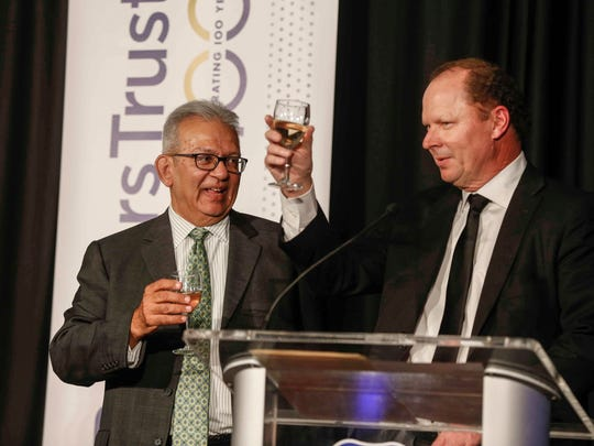 Bankers Trust CEO Suku Radia, left,  is toasted by Don Coffin at a retirement party for Radia at the is downtown Marriott. Coffin will take over as chief executive of the bank in January.