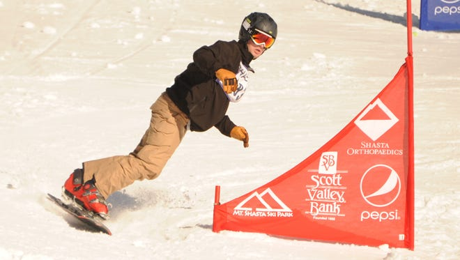 Shasta High's Kyle Gardner competes in the super slalom snowboard race Monday at the Mt. Shasta Ski Park. Gardner had the top male snowboard time.