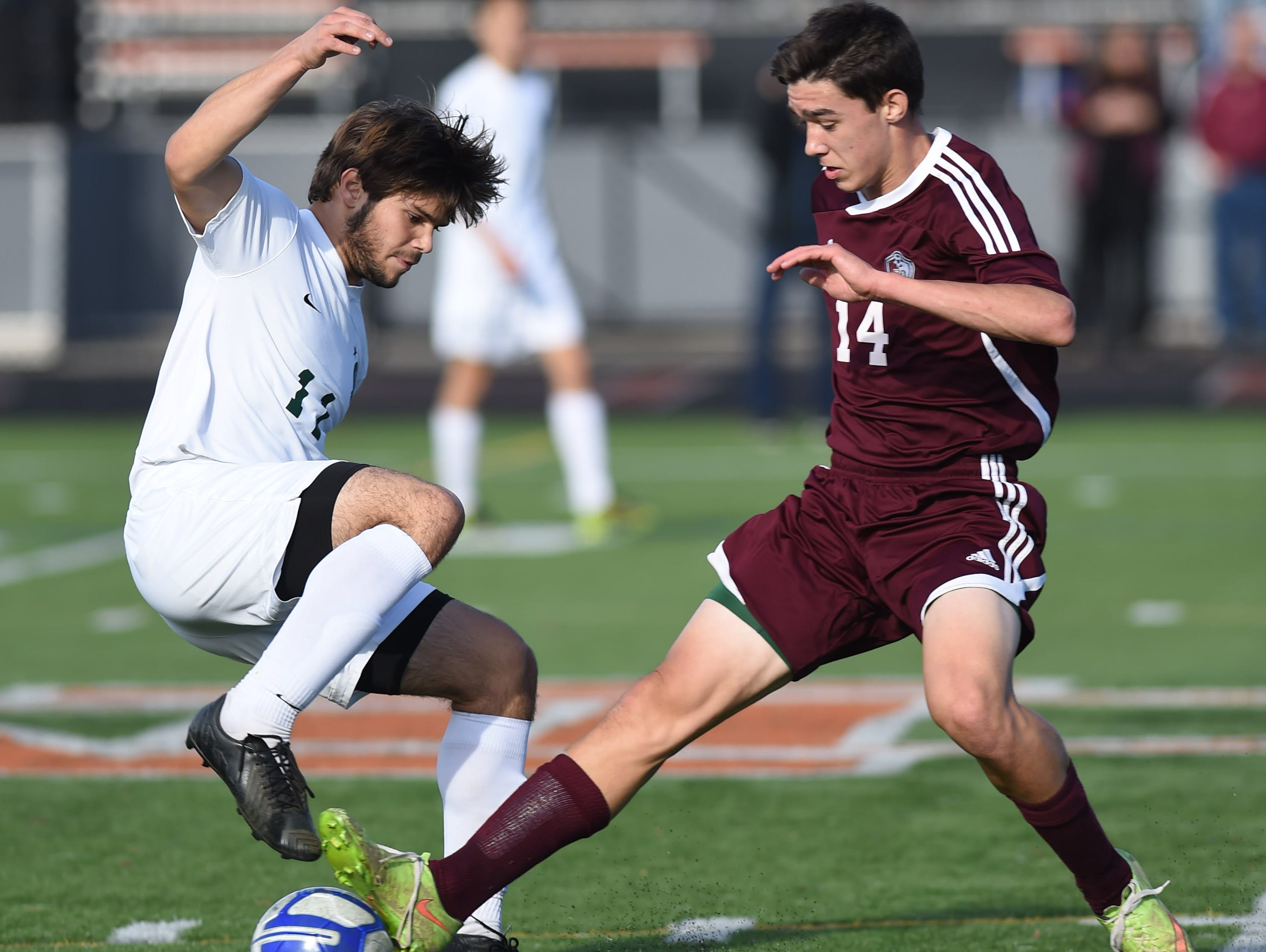 Spackenkill's Gaetano Citera keeps the ball away from O'Neill's Nolan Green during the Section 9 Class B final held in Marlboro on Saturday.